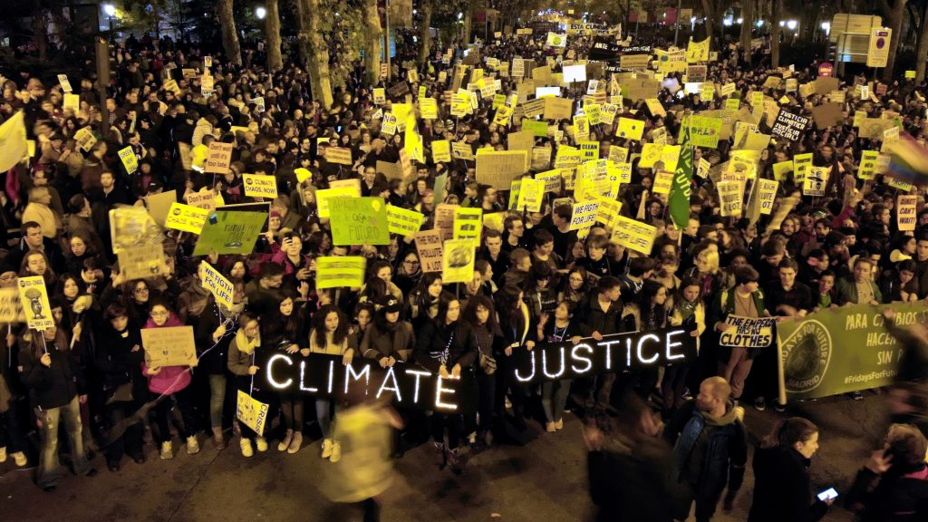 Thousands of protesters hit the streets of Madrid calling for climate action now. Photo by Allan Jay Quesada